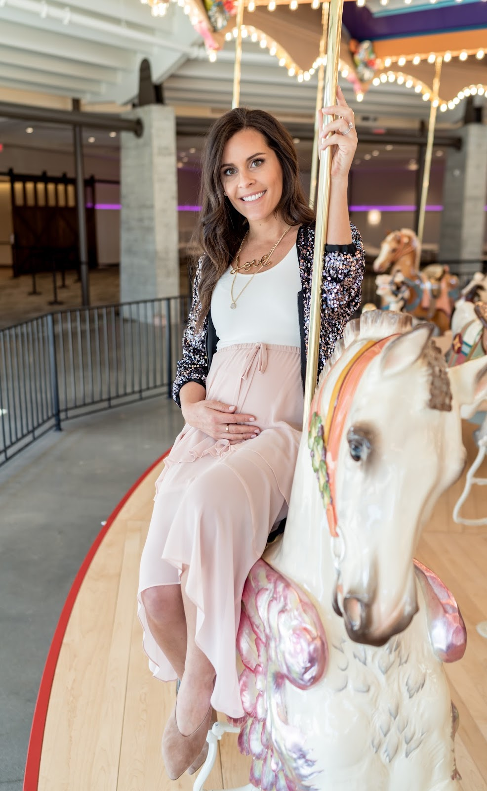 Maternity style with a flowy skirt and sequin jacket