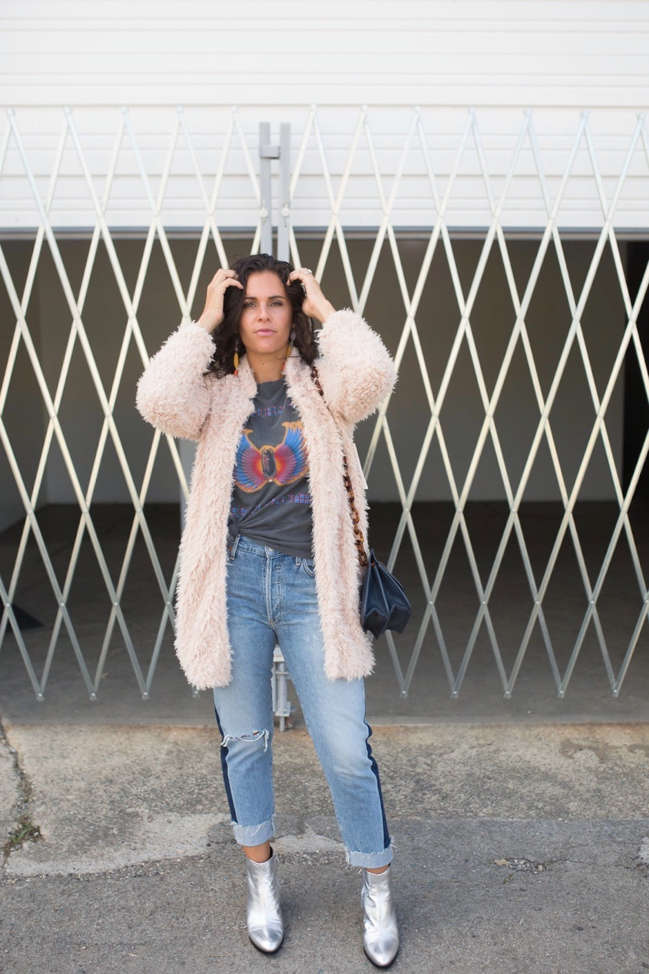 silver booties and a graphic tee
